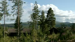 Forest Cabins Mountains Clouds Time Lapse - 25FPS PAL Stock Footage