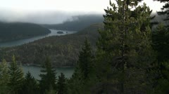 Nice over view of the Columbia River with pine trees foreground. Stock Footage