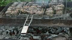 Shashlik fresh meat baked metal grid on fireplace fire heat Stock Footage