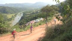 A group of cyclist on a  dirt road Stock Footage