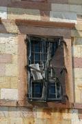 old unoccupied church window in candarli, turkey - stock photo