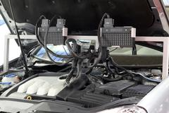 Car engine and diagnostic computer for auto electronics Stock Photos