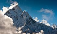 Stock Photo of mountain peaks and clouds in himalayas