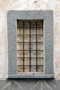 old unoccupied house window in candarli, turkey - stock photo