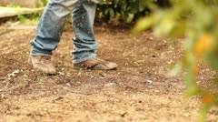 Man planting seeds Stock Footage
