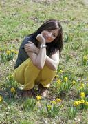 Young woman with daffodils Stock Photos