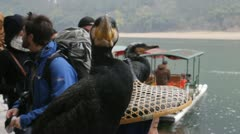 Guilin China tourist holding famous Cormorant fishing birds on bamboo Stock Footage