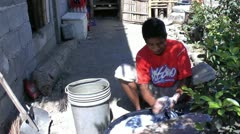 Filipino man handwashing clothes Stock Footage
