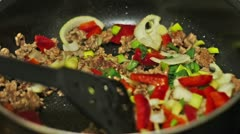 Preparing dinner. Frying meat with vegetables. Stock Footage