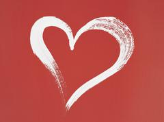 White heart painted on red background Stock Illustration
