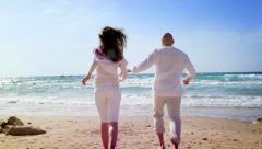 Loving pare on the beach Stock Footage