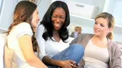 Pretty Multi Ethnic Female Friends Sitting Home Couch - stock footage