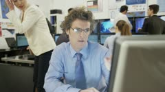 Diverse team of financial traders at work in the office - stock footage