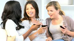 Young Caucasian African American Girls Drinking Wine Home Stock Footage