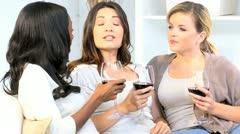 Pretty Multi Ethnic Female Friends Drinking Wine Home Stock Footage