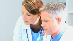 Caucasian Doctors Checking Medical Information - stock footage