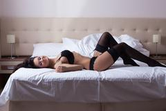 Passionate woman posing in sexy lingerie Stock Photos