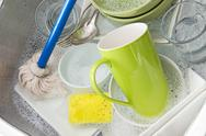 Washing bright dishes Stock Photos