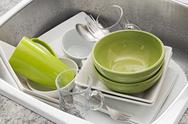 Washing dishes in the kitchen sink Stock Photos