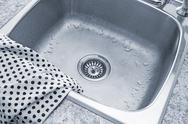 Clean sink and kitchen towel Stock Photos