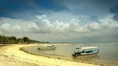 Sunny beach with boats Stock Footage