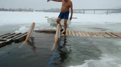 Swimming in the ice-hole on the river Stock Footage