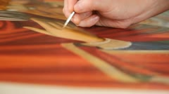Iconography. Icon painter at work in icon painting workshop. Stock Footage