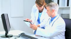 Hospital Doctors Accessing Patient Information Stock Footage