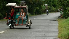Traffic on small road on Panay island in the Philippines Stock Footage