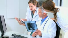 Radiologist Doctor Checking Patient X-Rays Tablet Stock Footage