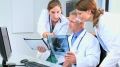 Medical Consultants Using Tablet Looking X-Ray Results - stock footage