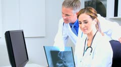 Medical Colleagues Checking Patient X-Rays Stock Footage