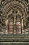 steps to a set of gothic church doors. - stock photo