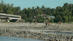 People picking stones in Sibalom river in the Republic of the Philippines Stock Footage