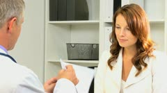 Female Business Executive with Male Medical Consultant Stock Footage