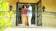 Stock Video Footage of Retired African American Couple Dancing Vacation Balcony