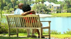 Retired Ethnic Couple Sitting Outdoors Stock Footage