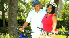 Retired Ethnic Couple Cycling for Fitness Stock Footage