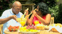 Mature Ethnic Couple Sharing Healthy Lunch Together Stock Footage