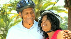 Mature African American Couple Cycling Outdoors Stock Footage