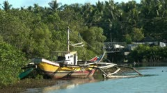 Traditional filipino banka ourigger fishing boats in the Philippines Stock Footage