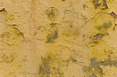 yellow rough painted concrete wall - stock photo