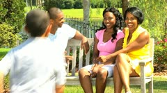 African American Family Greeting Young Sons Outdoors Stock Footage