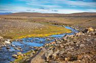 Stock Photo of summer iceland landscape with small river stream