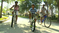 Healthy Fit Ethnic Family Cycling Suburban Roads - stock footage