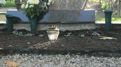 Candle glass pot burn near grave cemetery graveyard Stock Footage