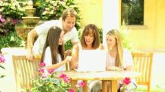 Parents Children in Garden Wireless Computer Stock Footage