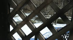 View wooden garden gate winter river water cataract ice snow Stock Footage