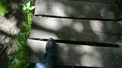 Man legs with black shoes go down on old wooden stair in park Stock Footage