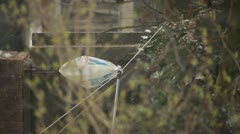 Plastic carrier bag blowing in snow and wind Stock Footage